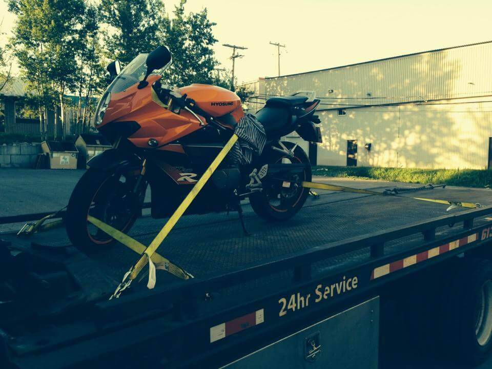 a motorcycle being towed in Ottawa